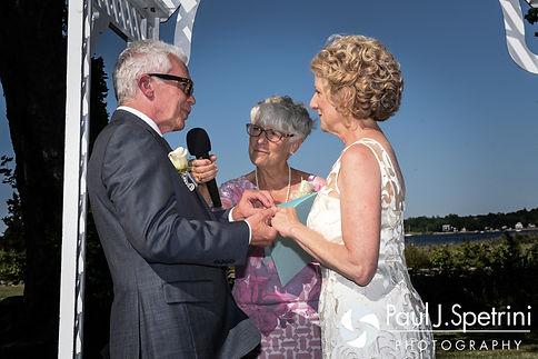Bob puts a ring on Debbie's hand during their June 2016 wedding in Barrington, Rhode Island.