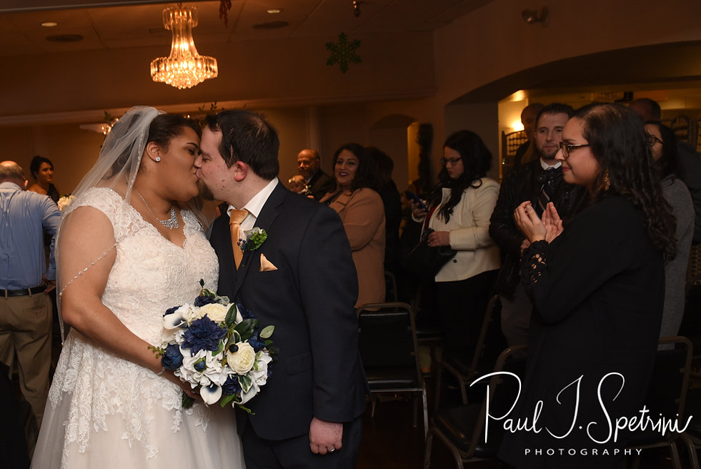 Gunnar and Aileen kiss following their December 2018 wedding ceremony at McGoverns on the Water in Fall River, Massachusetts.