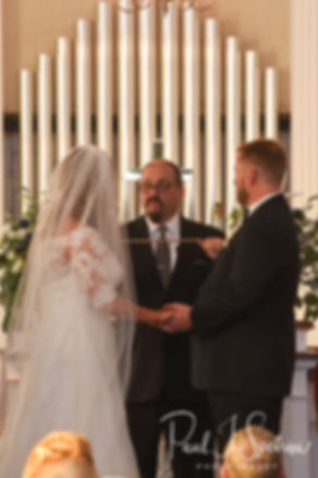 Cara and Brandon listen to their officant during their November 2018 wedding ceremony at First Baptist Church in Hope Valley, Rhode Island.