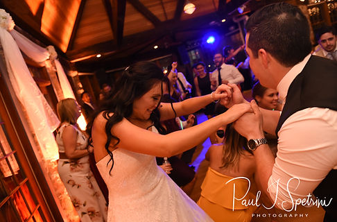 Nicole & Dan dance during their September 2018 wedding reception at The Towers in Narragansett, Rhode Island.