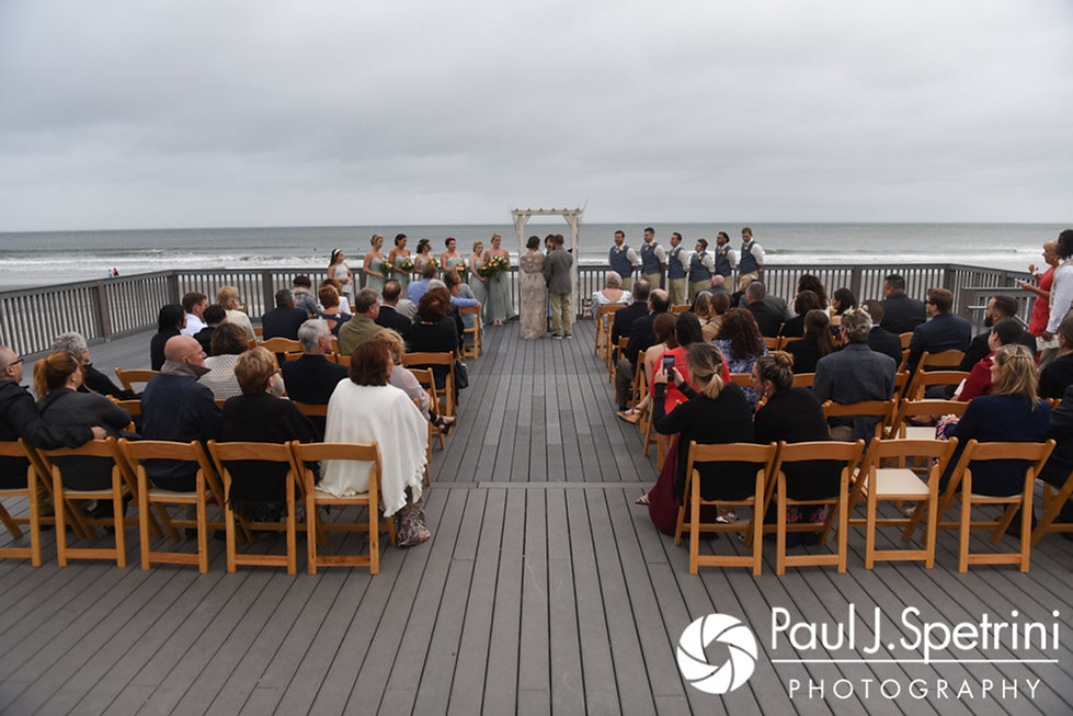 Arielle and Gary listen to their officiant during their September 2017 wedding ceremony at North Beach Club House in Narragansett, Rhode Island.