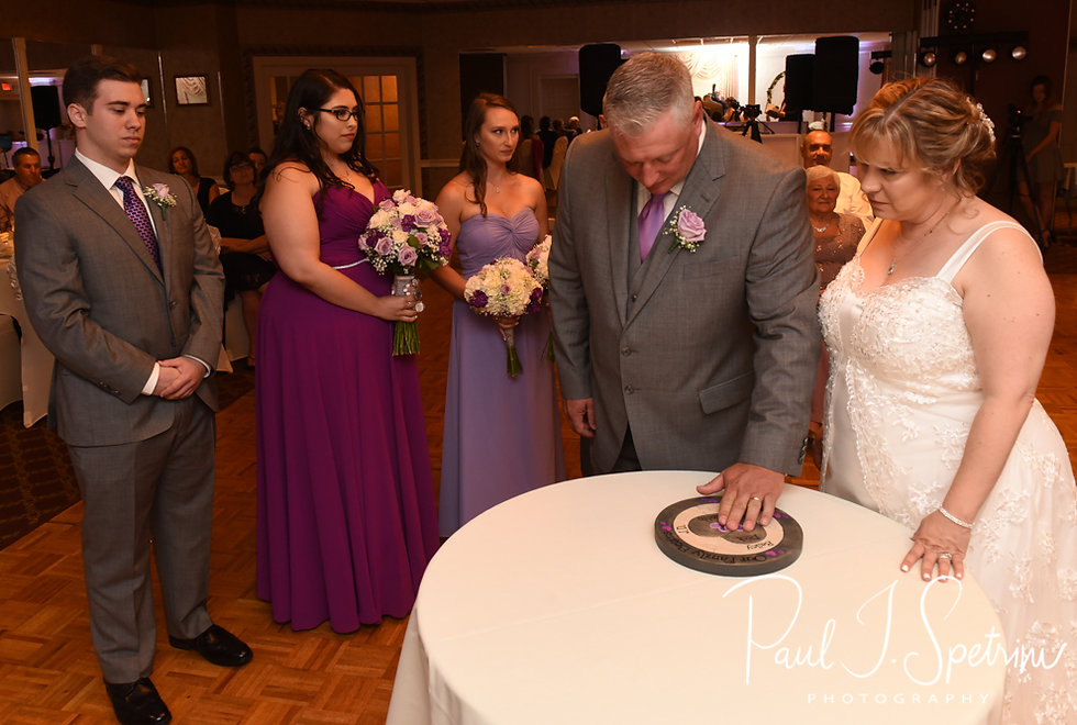 Robin and Rick complete a puzzle during their August 2018 wedding ceremony at Twelve Acres in Smithfield, Rhode Island.