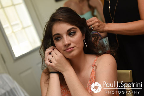 Gianna puts an earring on prior to her July 2017 wedding ceremony at Peace Dale Congregational Church in South Kingstown, Rhode Island.