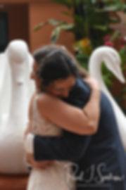 Amanda and Josh hug during their October 2018 wedding ceremony at the Walt Disney World Swan & Dolphin Resort in Lake Buena Vista, Florida.