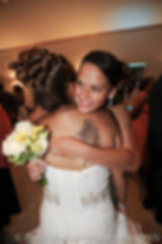 Jean Andrade hugs her son's fiancee.