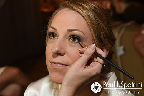 Kim has her makeup applied prior to her August 2016 wedding at Whispering Pines Conference Center in West Greenwich, Rhode Island.