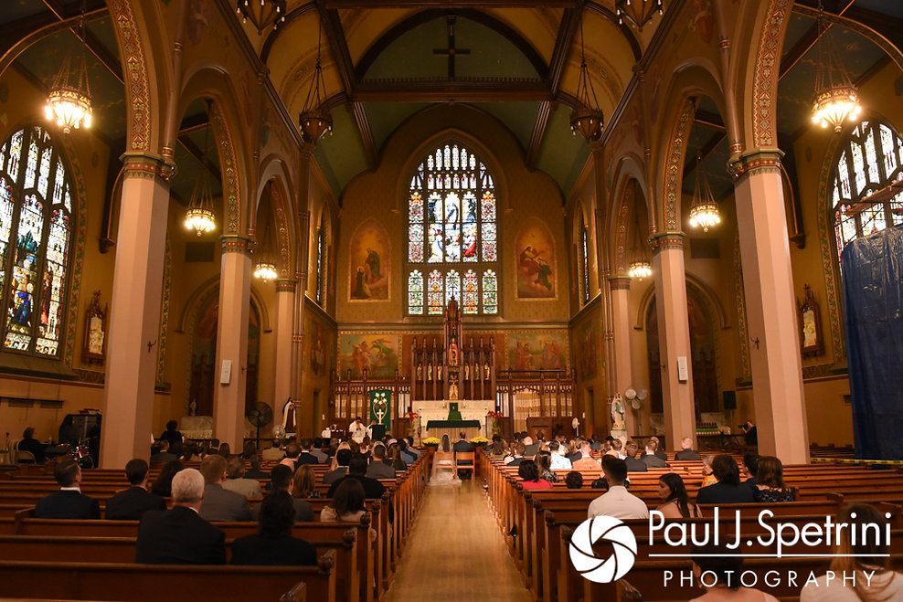 Jessica and Keiran sit during their October 2017 wedding ceremony at the Assumption of the Blessed Virgin Mary Church in Providence, Rhode Island.