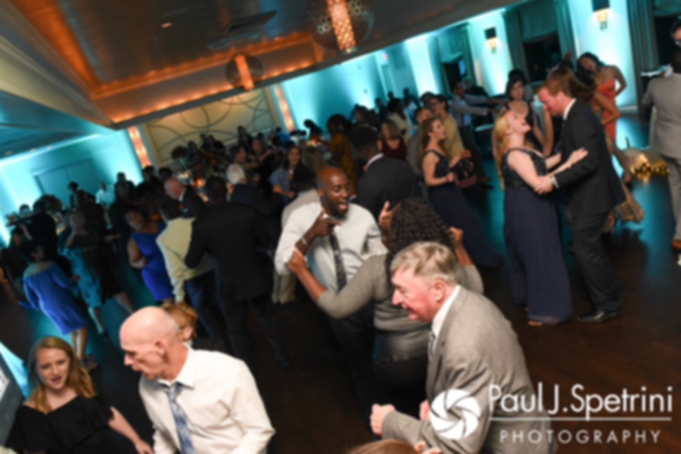 Guests dance during Kristina and Kevin's October 2017 wedding reception at the Villa Ridder Country Club in East Bridgewater, Massachusetts.