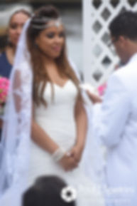 Lucelene listens as Luis speaks to her during her June 2017 wedding ceremony at Waterplace Park in Providence, Rhode Island.