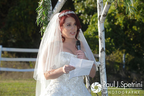 Brooke reads her vows during her October 2016 wedding ceremony at The Farm at SummitWynds in Jefferson, Massachusetts.