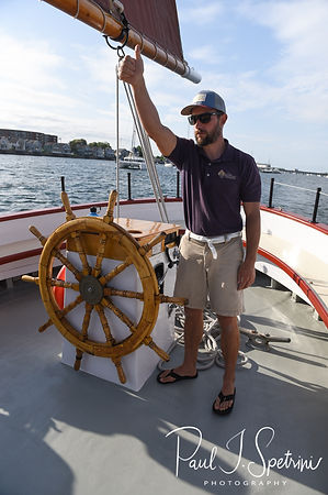 A member of the crew gives the thumbs up to sail the Schooner Aurora boat prior to Mike & Kate's May 2018 wedding ceremony in the waters off Newport, Rhode Island.