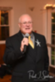The father of the bride gives a toast during Cara & Brandon's November 2018 wedding reception at the North Beach Clubhouse in Narragansett, Rhode Island.