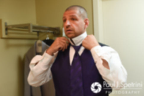 Kevin fixes his tie prior to his September 2017 wedding ceremony at Allen Hill Farm in Brooklyn, Connecticut.