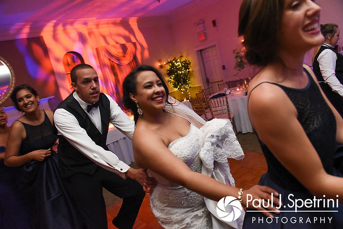 Stephany and Arten dance with guests during their September 2017 wedding reception at Wannamoisett Country Club in Rumford, Rhode Island.