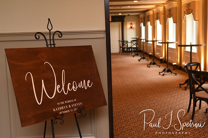 A sign hangs in the lobby prior to Katie & Steve's October 2018 wedding ceremony at The Villa at Ridder Country Club in East Bridgewater, Massachusetts.