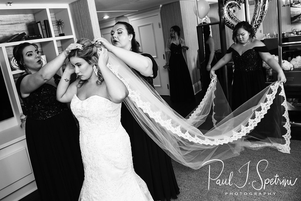 Sarah has her veil placed during her bridal prep session at The Omni Hotel in Providence, Rhode Island prior to her October 2018 wedding.