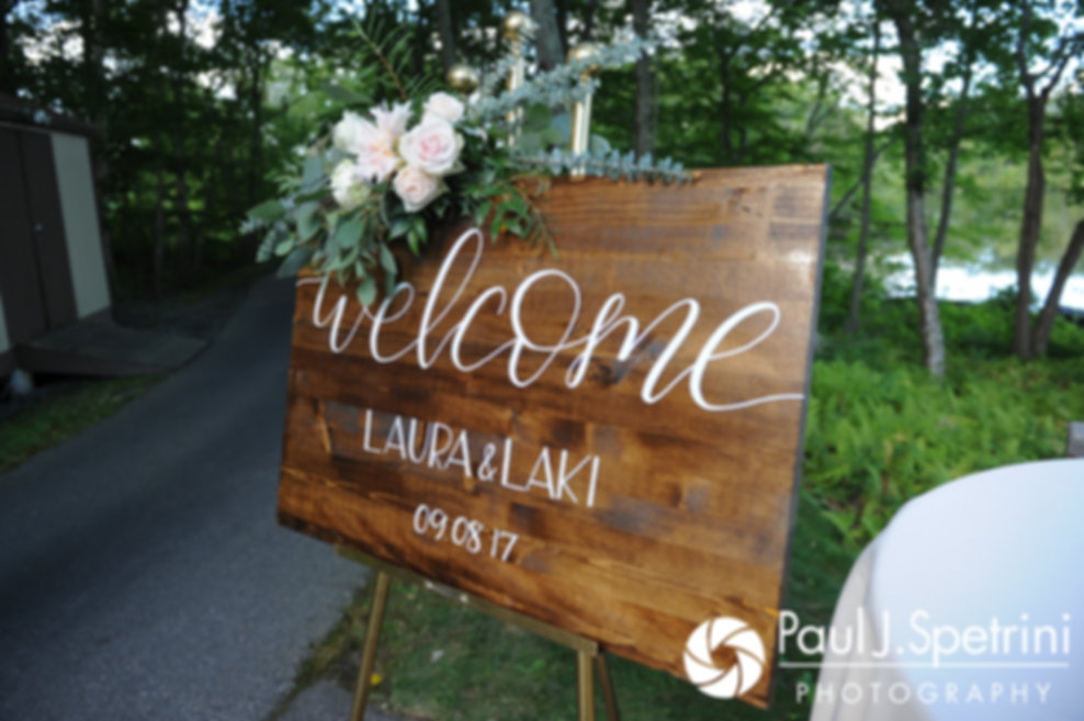 A sign welcoming guests is on display prior to Laura and Laki's September 2017 wedding ceremony at Lake of Isles Golf Club in North Stonington, Connecticut.