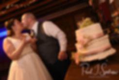 Adam & Ashley kiss after cutting their wedding cake during their September 2018 wedding reception at Stepping Stone Ranch in West Greenwich, Rhode Island.