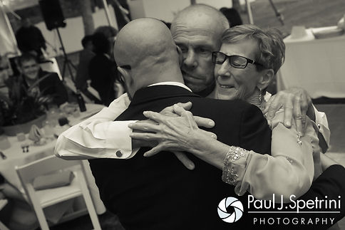Forrester hugs his parents during his October 2016 wedding reception in Charlestown, Rhode Island.