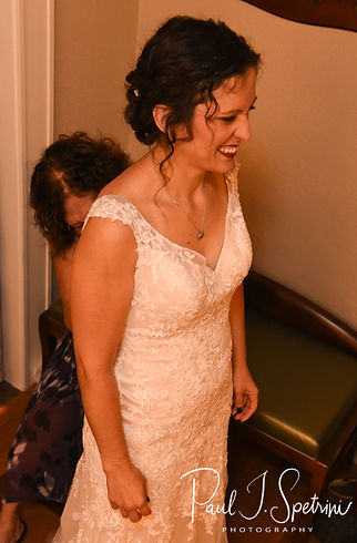 Amanda has her dress zipped up prior to her October 2018 wedding ceremony at the Walt Disney World Swan & Dolphin Resort in Lake Buena Vista, Florida.