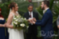 Ali and Gary exchange rings during their May 2018 wedding ceremony at the Roger Williams Park Botanical Center in Providence, Rhode Island.