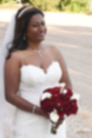 Saken poses for a photo following her July 2018 wedding ceremony at Lake Pearl in Wrentham, Massachusetts.