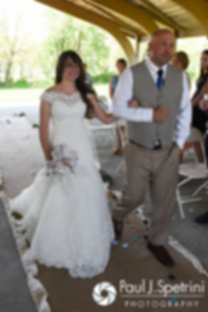 Krystal is escorted down the aisle by her father during her May 2016 wedding at Colt State Park in Bristol, Rhode Island.