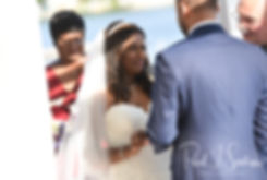 Saken places the ring on Jimmy's finger during her July 2018 wedding ceremony at Lake Pearl in Wrentham, Massachusetts.