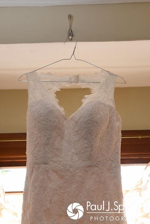 Rachel's dress hangs up prior to her October 2017 wedding ceremony at Castle Manor Inn in Gloucester, Massachusetts.