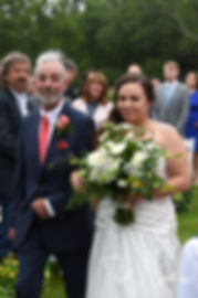 Laura walks down the aisle during her June 2018 wedding ceremony at Independence Harbor in Assonet, Massachusetts.