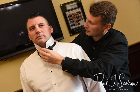 Brian has his tie put on prior to his September 2018 wedding ceremony, at Gents Barbershop and Spa in Cranston, Rhode Island.