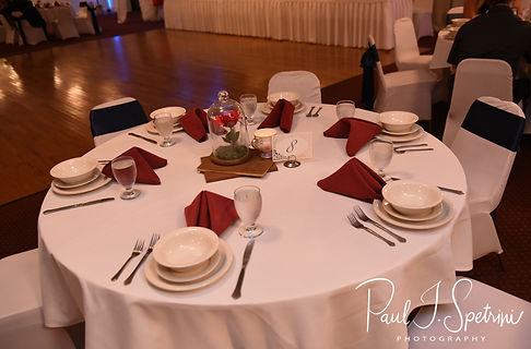 A look at the table settings prior to Courtnie and Richardson's August 2018 wedding reception at Emerald Hall in Abington, Massachusetts.