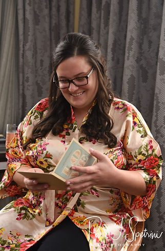 Katie reads a letter from Steve during bridal prep prior to her October 2018 wedding ceremony at The Villa at Ridder Country Club in East Bridgewater, Massachusetts.