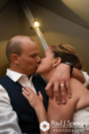 Rebecca and Kelly kiss during their August 2017 wedding reception in Warwick, Rhode Island.