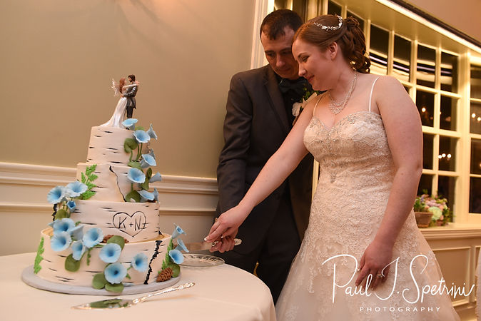 Nate and Kaytii cut their cake during their May 2018 wedding reception at Meadowbrook Inn in Charlestown, Rhode Island.