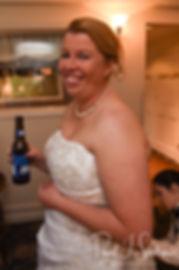 Marjike has her dress bustled during her June 2018 wedding reception at Independence Harbor in Assonet, Massachusetts.