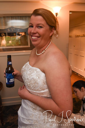 Marjike has her dress bustled during her June 2018 wedding reception at Independence Harbor in Assonet, Massachusetts.