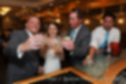 Justin and Jamie Bolani do a celebratory shot during their wedding reception in Bristol, Rhode Island in June 2015.