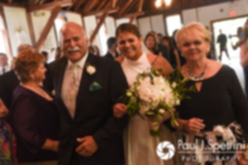 Molly walks down the aisle with her parents during her June 2017 wedding ceremony at Saint Romuald Chapel in Matunuck, Rhode Island.