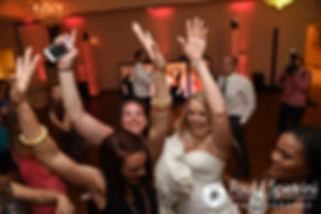 Guests dance during Michelle and Eric's May 2016 wedding at Hillside Country Club in Rehoboth, Massachusetts.