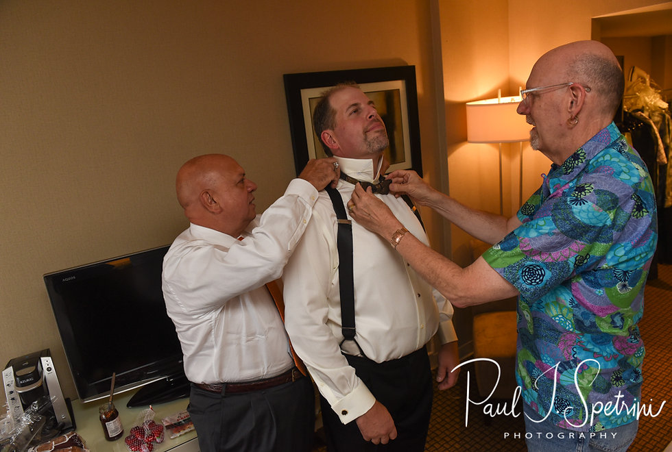 Bob has help putting his tie on prior to his August 2018 wedding ceremony at the Walter J. Dempsey Memorial Bandstand in Norwood, Massachusetts.