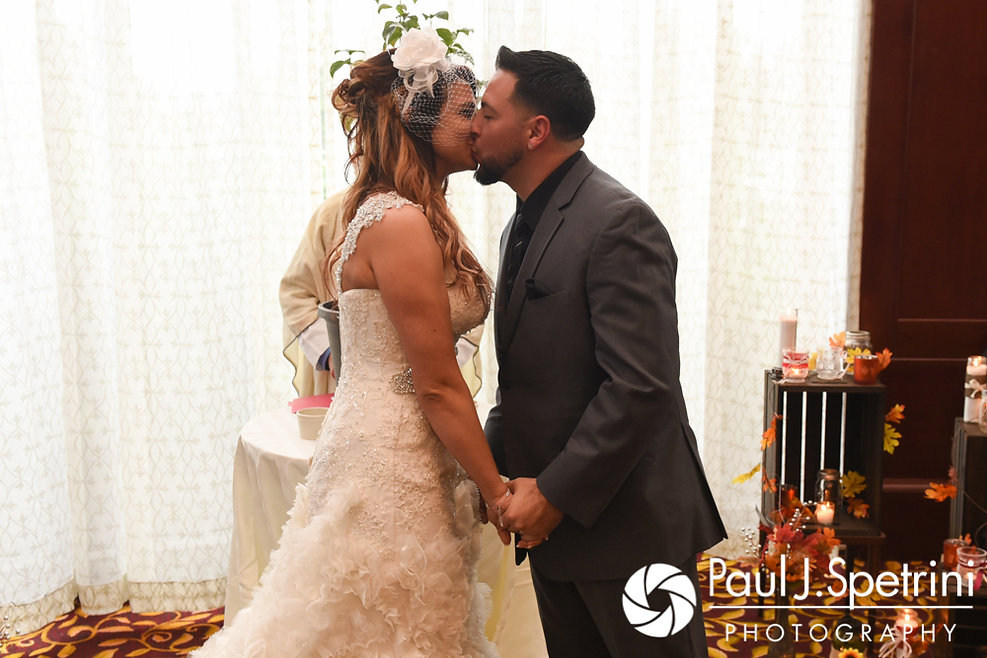 Dallas and Nicky kiss during their September 2017 wedding ceremony at the Crowne Plaza Hotel in Warwick, Rhode Island.