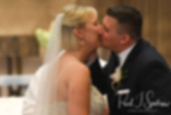 Meghan and Brian kiss during their September2018 wedding ceremony at Immaculate Conception Church in Cranston, Rhode Island.