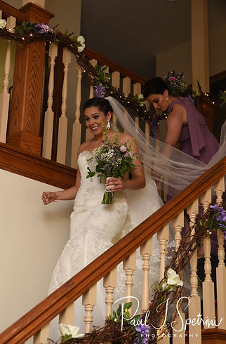 Kendra walks down the stairs prior to her May 2018 wedding ceremony at Crystal Lake Golf Club in Mapleville, Rhode Island.