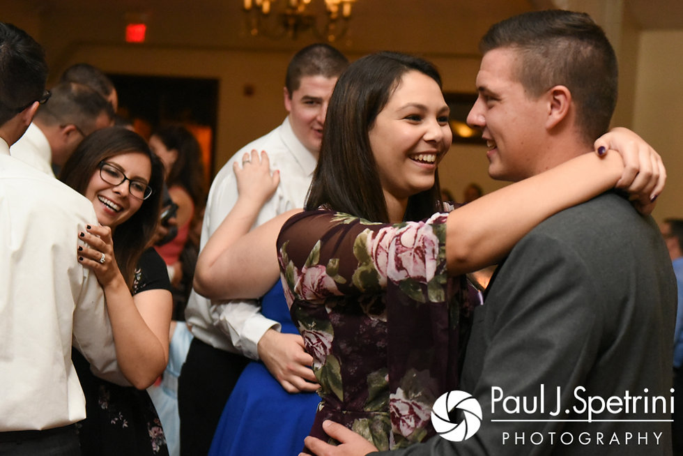 Guests dance during Kevin and Joanna's October 2017 wedding reception at Cranston Country Club in Cranston, Rhode Island.