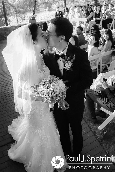 Cynthia and Ao kiss following their August 2017 wedding ceremony at Lake Pearl in Wrentham, Massachusetts.