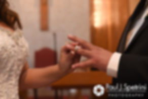 Stephanie and Henry exchange rings during their October 2016 wedding ceremony at the Historic St. Joseph Church in Cumberland, Rhode Island.