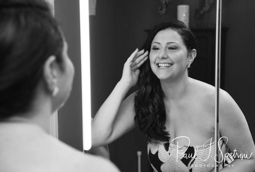 Stephanie checks out her makeup prior to her June 2018 wedding ceremony at Foster Country Club in Foster, Rhode Island.