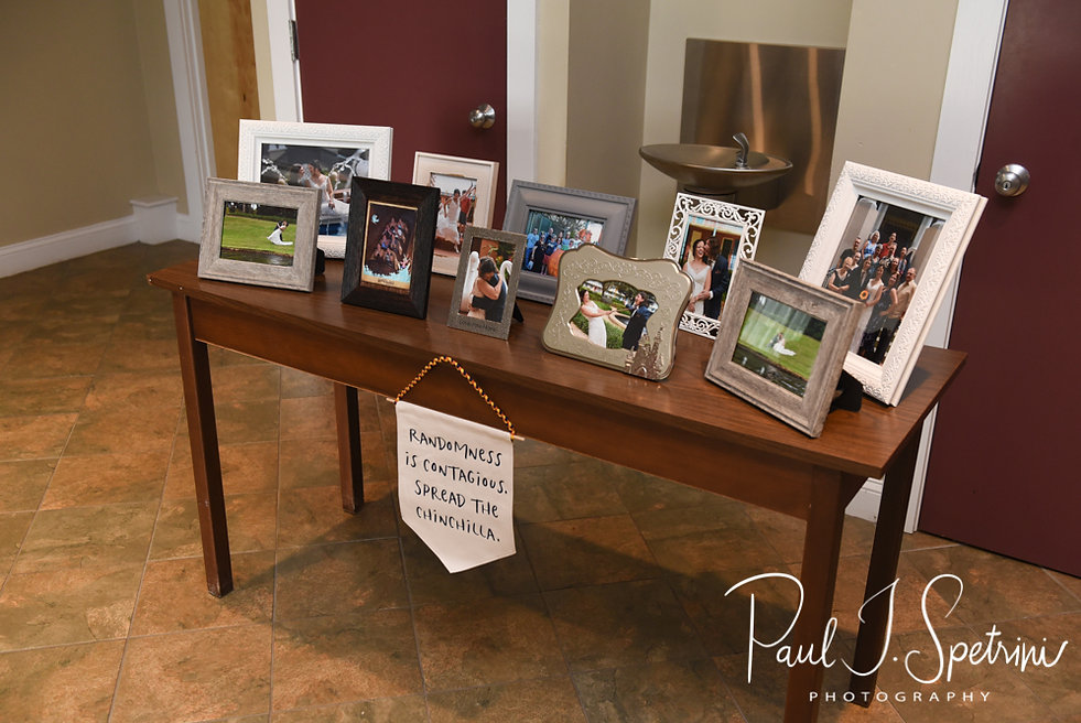 A look at some of Amanda and Josh's wedding photos, on display prior to their October 2018 wedding reception at Loon Pond Lodge in Lakeville, Massachusetts.