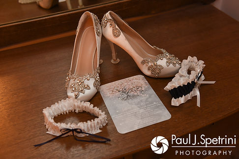 A look at Clarissa's shoes, garter belt and invitiation prior to Jeffrey and Clarissa's June 2017 wedding ceremony at Twelve Acres in Smithfield, Rhode Island.